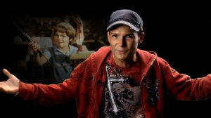 Narrator Corey Feldman. No, don't run away, he's okay in it!