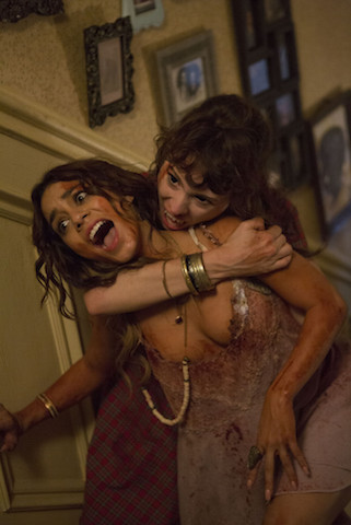 "Mackenzie Davis, right, and Vanessa Hudgens in Columbia Pictures' ""Freaks of Nature."""